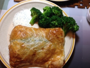 A little freshly blanched broccoli and yuzu dill creme fraiche sauce of the salmon en croute