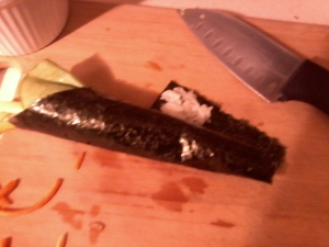 Finishing up a temaki roll